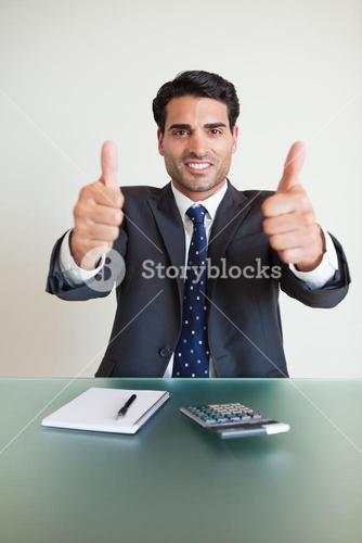 Portrait of an accountant with the thumbs up