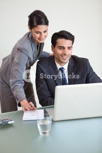 Portrait of sales persons working with a laptop