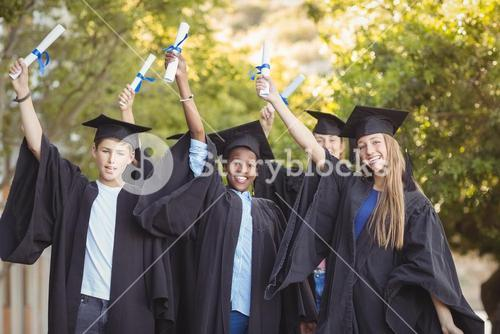 Portrait of graduate school kids standing with degree scroll in campus