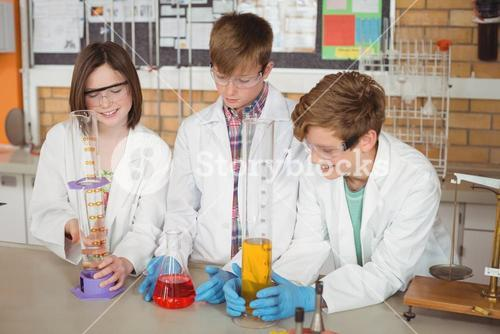 Schoolkids doing a chemical experiment in laboratory