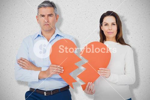 Composite image of portrait of couple holding broken heart shape paper