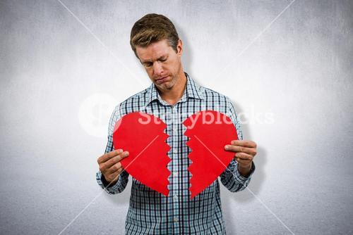 Composite image of sad man holding a broken card