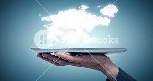 Composite image of cropped image of businessman holding tablet computer
