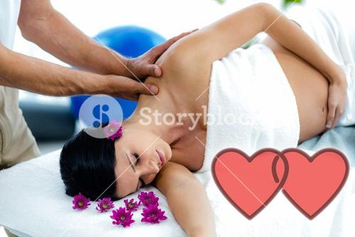 Composite image of a pregnant woman receiving a shoulder massage with love hearts