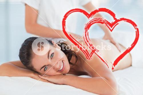 Composite image of a massage session with love hearts