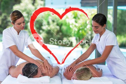 Composite image of a couple receiving a massage