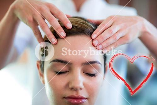 Composite image of a head massage on a woman with a love heart