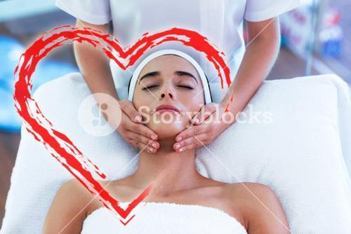 Composite image of a massage session with love heart