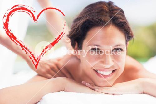 Composite image of a smiling woman on her massage session
