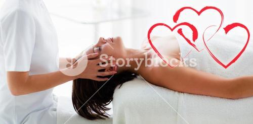 Composite image of head massage with love hearts