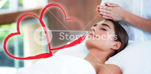Composite image of woman on her massage session with love hearts