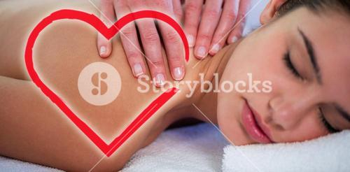 Composite image of woman receiving massage love heart