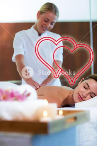 Composite image of a massage session love hearts