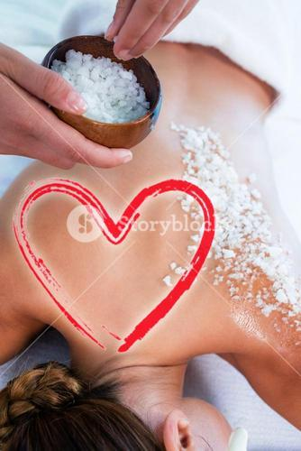 Composite image of salt scrub massage with love heart