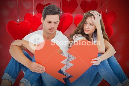 Composite image of young couple sitting on floor with broken heart shape paper 3d