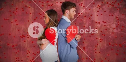 Composite image of side view of young couple holding broken heart