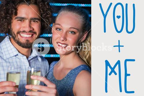 Composite image of portrait of couple holding glass of champagne in bar