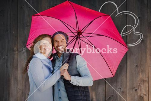 Composite image of happy young couple holding pink umbrella