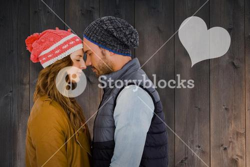 Composite image of happy young couple standing face to face