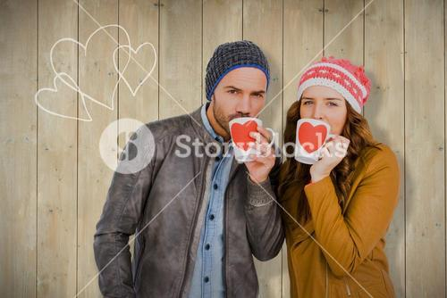 Composite image of portrait of young couple having coffee