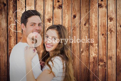 Composite image of portrait of couple hugging