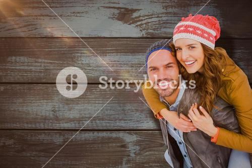 Composite image of man giving piggyback ride to woman