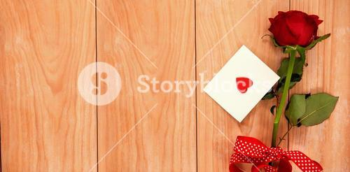 red heart envelope and a red rose