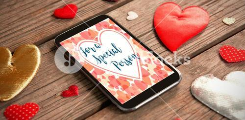 Web against tablet and heart decoration