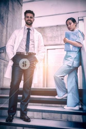 Doctor and nurse standing on staircase