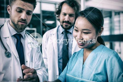 Doctors and nurse having discussion
