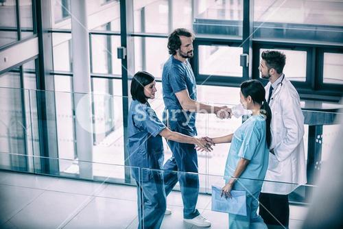 Surgeons shaking hands with each other