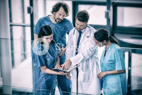 Surgeons discussing with nurse