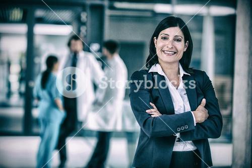 Businesswoman with hands folded