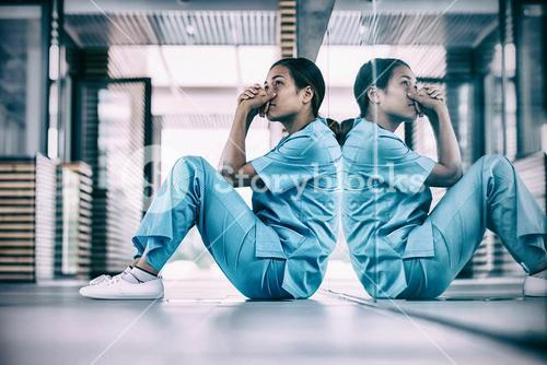 Nurse sitting on floor