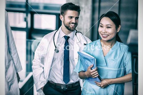 Happy doctor and nurse in hospital