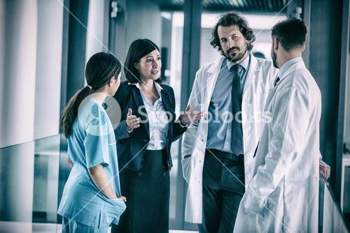 Businesswoman talking with doctors
