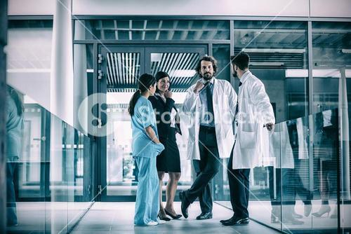 Businesswoman interacting with doctors