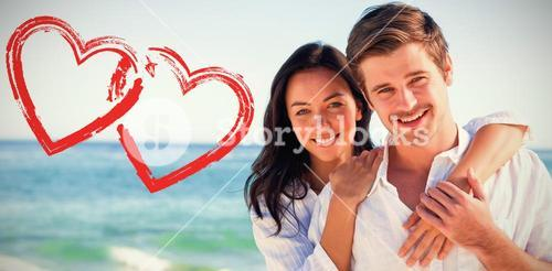 Composite image of cheerful couple embracing on the beach
