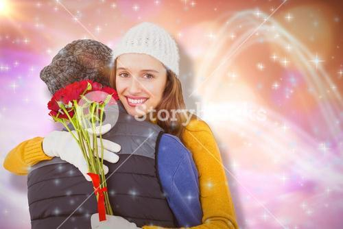 Composite image of couple hugging each other with red roses