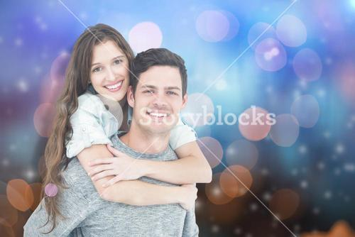 Composite image of couple embracing with arms around
