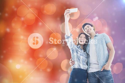 Composite image of happy young couple taking selfie