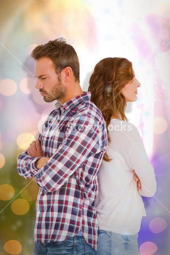 Composite image of depressed couple standing back to back