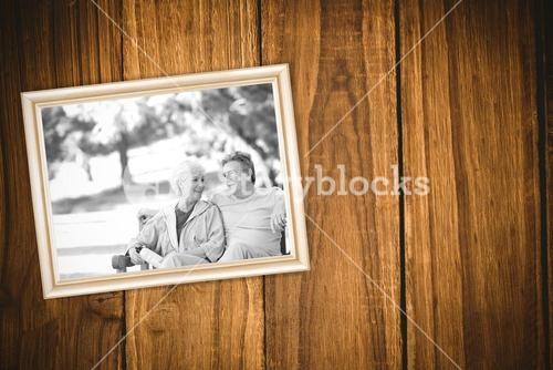 Composite image of elderly couple with their bikes
