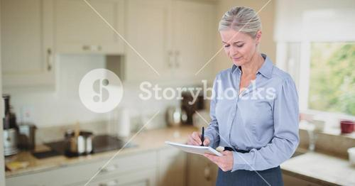 Female executive writing in notepad