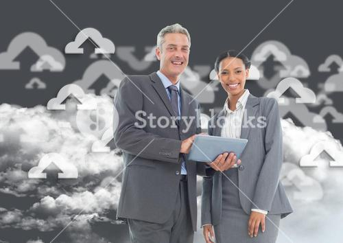 Happy businessman and businesswoman using digital tablet
