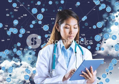 Female doctor with stethoscope using digital tablet