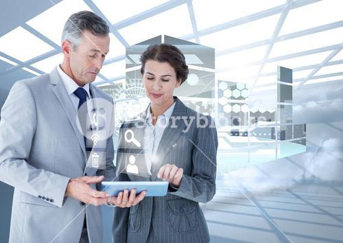 Business executives using digital tablet against digital interface in background