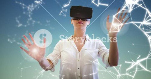 Woman using virtual reality headset against sky