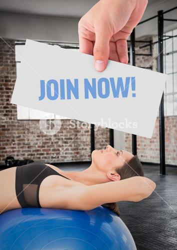 Fitness woman lying over exerciseball with hand holding text with placard