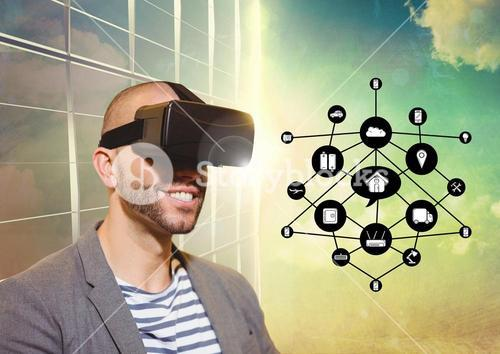 Man using virtual reality headset with digitally generated icons
